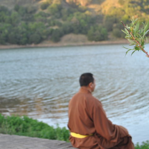 Rinpoche-sitting-in-front-water